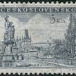 Stock Photo: Postage stamp printed in Czechoslovakishows Prague - Charles Bridg, statue of St. Luitgard by Matthias Braun and Prague Castle