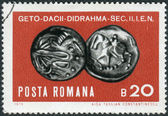 Postage stamp printed in Romania shows ancient coins: Getic-Dacian silver didrachm 2nd-1st century B.C. — Stock Photo