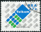 Postage stamp printed in South Africa, shows the emblem of Telkom — Stock Photo