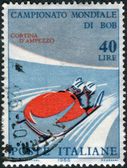 Postage stamp printed in Italy, dedicated to World Bobsleigh Championships, shows Two-man bobsleigh — Stock Photo