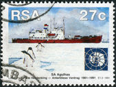 Postage stamp printed in South Africa, devoted to 30th anniversary of Antarctic Treaty, shows a ice-strengthened training ship and former polar research vessel S.A. Agulhas — Zdjęcie stockowe
