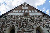Detail of the facade of stone medieval church. The Church of St. Mary in Hollola. Finland. — Stock Photo