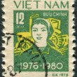 Stock Photo: Postage stamp printed in Vietnam shows Peasant woman