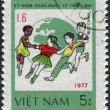 Postage stamp printed in Vietnam, dedicated to International Children's Day (1977), shows Children dance around Globe — Stock Photo #42417749