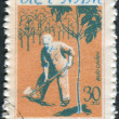 Postage stamp printed in Vietnam shows President Ho Chi Minh plant a tree — Stock Photo