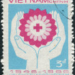 Stock Photo: Postage stamp printed in Vietnam, dedicated to 40th Anniversary of Vietnamese Red Cross