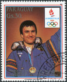 Postage stamp printed in Paraguay, devoted Winter Olympic Games in Albertville, shown medalist Winter Olympic Games in Calgary, Franck Piccard — Stock Photo