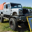 Постер, плакат: Off road Land Rover Defender 109 Bigfoot Monstertruck
