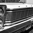 Постер, плакат: Detail of the front of the full size car Ford Galaxie 500 Third generation black and white