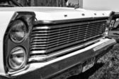 Detail of the front of the full-size car Ford Galaxie 500 (Third generation), black and white — Stock Photo