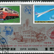 Postage stamp printed in North Korea, dedicated to 40th Anniversary of the issue of stamp of the DPR Korea, shows a diesel locomotive Kumsong and airplane Aerospatiale-BAC Concorde — Stock Photo #42991813