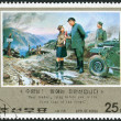 Postage stamp printed in North Korea, dedicated Revolutionary Activities of Kim Il Sung, shows On muddy road at front with driver and girl — Stock Photo #42994349