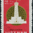 Postage stamp printed in Vietnam, devoted to the first anniversary of the elections to the National Assembly, shows Bronze drum and Thang Long Flag Tower, Hanoi — Stock Photo