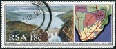 Postage stamp printed in South Africa, shows Cahora Bassa Dam and map landscape — Stock Photo