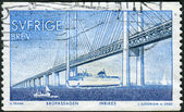 Postage stamp printed in Sweden, Completion of a fixed link between Denmark and Sweden across, shows the Oresund Bridge — Stock Photo