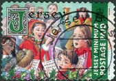 Postage stamp printed in Jersey (Crown dependencies of the British Crown), Christmas Issue, shows children sing Christmas songs — Stock Photo