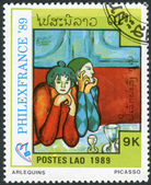 Postage stamp printed in Laos dedicated to the Philexfrance 89 international stamp exibition Paris, shows Harlequins, by Pablo Picasso — Stok fotoğraf