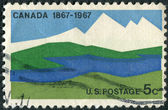 Postage stamp printed in USA, dedicated to Centenary of Canada's emergence as a nation, shows Canadian Landscapes — Foto de Stock