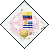 Postage stamp printed in Hungary, is dedicated to Football World Cup, Chile, shows Colombian and Uruguayan flags — Stok fotoğraf