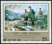 Postage stamp printed in North Korea, dedicated Revolutionary Activities of Kim Il Sung, shows On muddy road at front with driver and girl — Stok fotoğraf