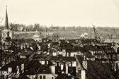 Roofs of old Prague. Stylized film. Large grains. Sepia. Toning. — Stock Photo