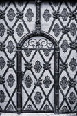 Ancient gate in the historic center of Prague. Black and white. Stylized. — Stock Photo