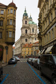 The streets of old Prague. Saint Nicholas Cathedral — Stock Photo