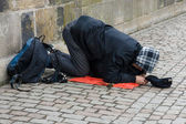 Beggar on Charles Bridge. Prague. — Stock Photo