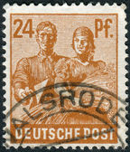Postage stamp printed in Germany, shows Reaping Wheat — Stock Photo