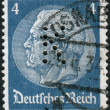 "Postage stamp printed in Germany (German Reich) with perfin ""K"", shows the 2nd President of Germany, Paul von Hindenburg — Stock Photo #44722525"