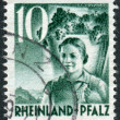 Postage stamp printed in Germany (Rhineland-Palatinate, French occupation zone), shows Girl Carrying Grapes — Stock Photo #44723647