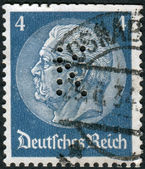 """Postage stamp printed in Germany (German Reich) with perfin """"K"""", shows the 2nd President of Germany, Paul von Hindenburg — Stock Photo"""