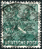 Postage stamp printed in Germany (overpint Type B: US and British occupation zone), shows the Reaping Wheat — Stock Photo