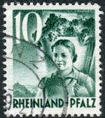 Postage stamp printed in Germany (Rhineland-Palatinate, French occupation zone), shows Girl Carrying Grapes — Stock Photo