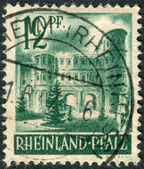 Postage stamp printed in Germany (Rhineland-Palatinate, French occupation zone), shows Porta Nigra, Trier — Stock Photo