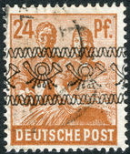 Postage stamp printed in Germany (overpint Type A: US and British occupation zone), shows the Reaping Wheat — Stock Photo
