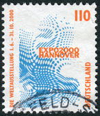 Postage stamp printed in Germany, shows Emblem of the World Exhibition EXPO 2000, Hannover — Stock Photo