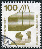 Postage stamp printed in Germany, Prevent accidents Issue, shows Hoisted cargo — Stock Photo