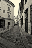 The streets of old Prague. Stylized film. Large grains. Sepia — Stock Photo