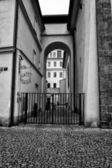 The streets of old Prague. Stylized film. Large grains. Black and White. — Stock Photo