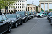Police guarding the convoy of cars with very important people near the Brandenburg Gate — Stock Photo