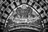 Mosaic. Pointer to name the bridge Oberbaumbruecke. Berlin. Germany. — Stock Photo