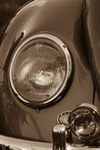 Headlamp vintage car close-up. Sepia. — Stock Photo