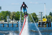 Demonstration performance at Flyboard. 2nd Berlin water sports festival in Gruenau. — Stock Photo