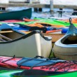 Sport boats, kayaks and canoes at the marina. — Stock Photo #46283367