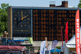 Electronic scoreboard with a schedule of performances of the festival. — Stock Photo