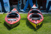 Sport boats, kayaks and canoes at the marina. — Stock Photo