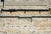 Old brick wall of the building and crumbling plaster. — Stock Photo