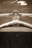 BERLIN, GERMANY - MAY 17, 2014: Hood ornament of the Opel 1.2-litre Cabrio-Limousine (1934). Sepia. 27th Oldtimer Day Berlin - Brandenburg — Stock Photo