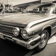 Постер, плакат: BERLIN GERMANY MAY 17 2014: Full size car Buick LeSabre 4 Door Sedan 1962 Black and white 27th Oldtimer Day Berlin Brandenburg